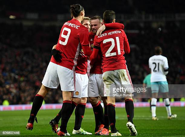 Zlatan Ibrahimovic of Manchester United celebrates with team mates after scoring his team's fourth goal of the game during the EFL Cup quarter final...