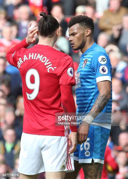 Zlatan Ibrahimovic of Manchester United clashes with Tyrone Mings of AFC Bournemouth during the Premier League match between Manchester United and...