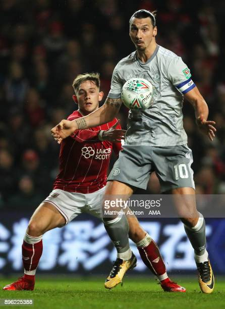 Zlatan Ibrahimovic of Manchester United competes with Josh Brownhill of Bristol City during the Carabao Cup QuarterFinal match between Bristol City...