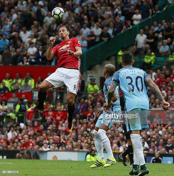 Zlatan Ibrahimovic of Manchester United goes up for a header during the Premier League match between Manchester United and Manchester City at Old...