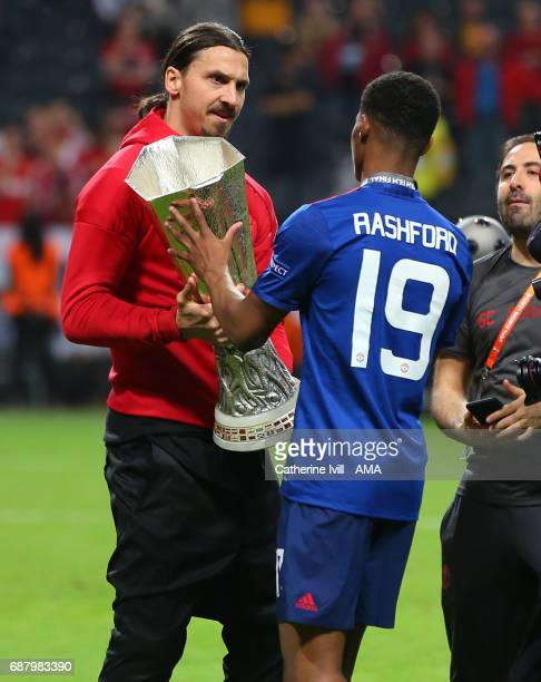 Zlatan Ibrahimovic of Manchester United hands the trophy to Marcus Rashford of Manchester United during the UEFA Europa League Final match between...