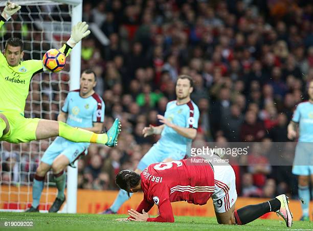 Zlatan Ibrahimovic of Manchester United has a shot on goal saved by Tom Heaton of Burnley during the Premier League match between Manchester United...