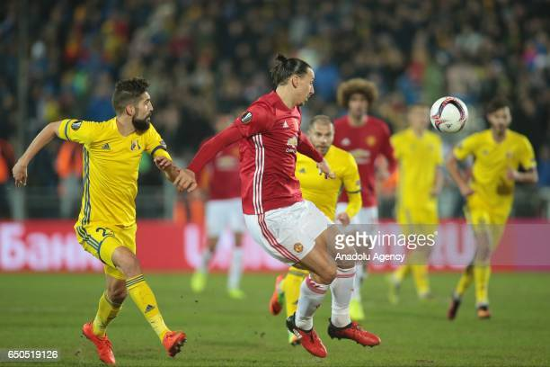 Zlatan Ibrahimovic of Manchester United in action against Miha Mevlja of FC Rostov during the UEFA Europa League Round of 16 first leg match between...