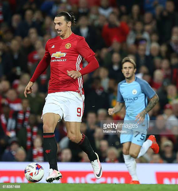 Zlatan Ibrahimovic of Manchester United in action with Aleix Garcia of Manchester City during the EFL Cup Fourth Round match between Manchester...