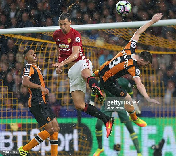 Zlatan Ibrahimovic of Manchester United in action with Andrew Robertson of Hull City during the Premier League match between Manchester United and...