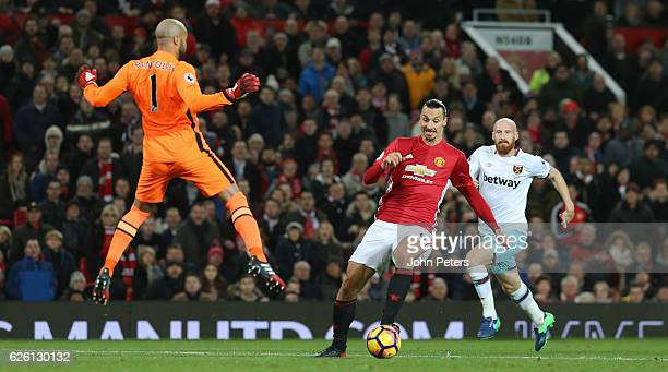 Zlatan Ibrahimovic of Manchester United in action with Darren Randolph of West Ham United during the Premier League match between Manchester United...
