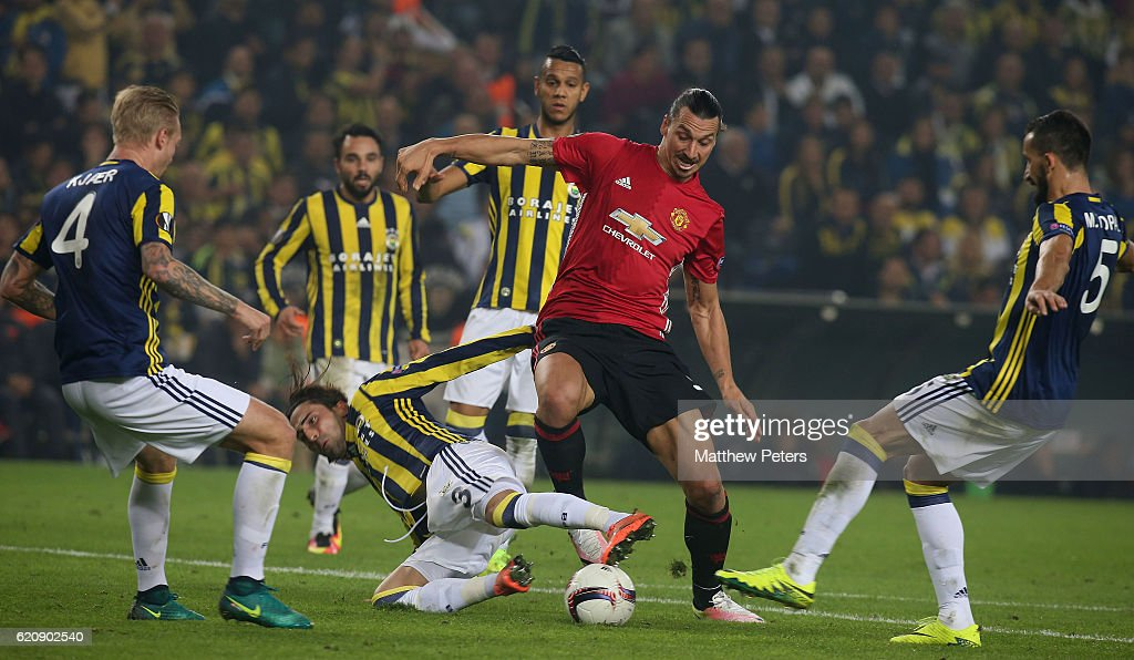 Zlatan Ibrahimovic of Manchester United in action with Hasan Ali Kaldirim of Fenerbahce during the UEFA Europa League match between Manchester United and Fenerbahce at sukru Saracoglu Stadium on November 3, 2016 in Istanbul, Turkey.