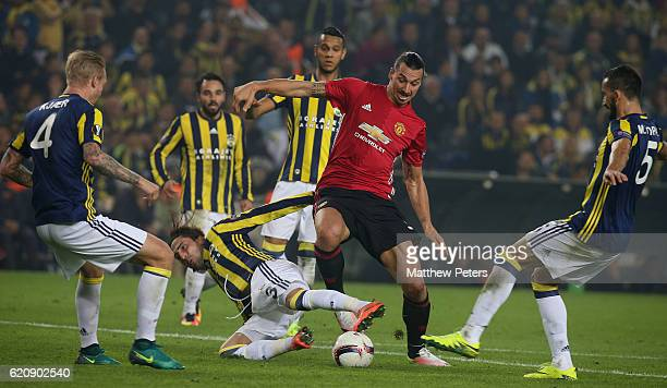 Zlatan Ibrahimovic of Manchester United in action with Hasan Ali Kaldirim of Fenerbahce during the UEFA Europa League match between Manchester United...