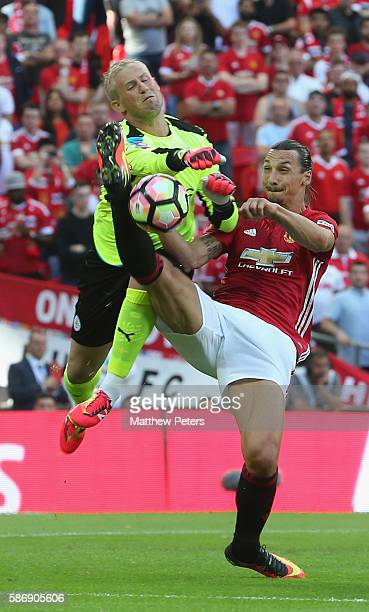 Zlatan Ibrahimovic of Manchester United in action with Kasper Schmeichel of Leicester City during the FA Community Shield match between Leicester...