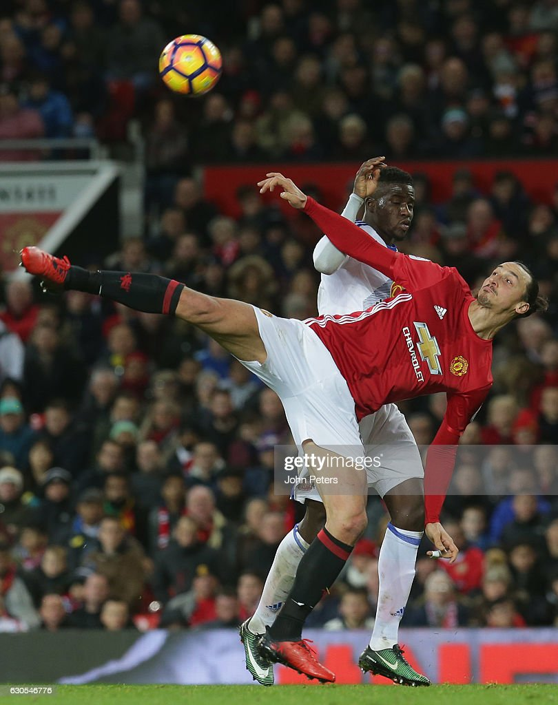Zlatan Ibrahimovic of Manchester United in action with Lamine Kone of Sunderland during the Premier League match between Manchester United and Sunderland at Old Trafford on December 26, 2016 in Manchester, England.