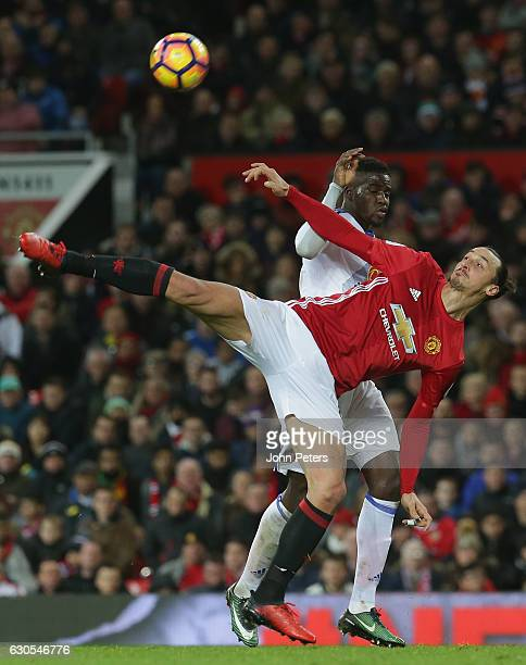 Zlatan Ibrahimovic of Manchester United in action with Lamine Kone of Sunderland during the Premier League match between Manchester United and...