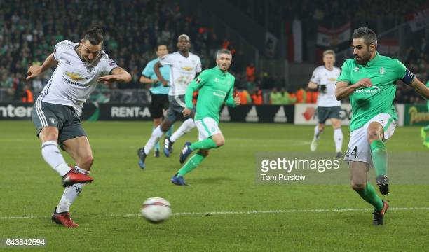 Zlatan Ibrahimovic of Manchester United in action with Loic Perrin of AS SaintEtienne during the UEFA Europa League Round of 32 second leg match...