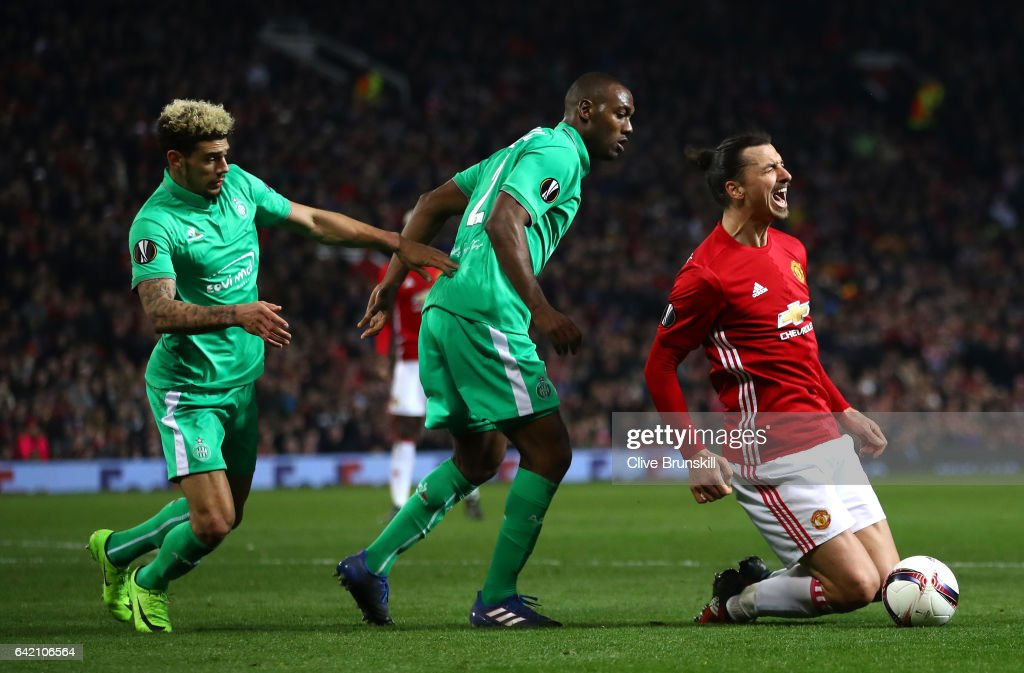 Zlatan Ibrahimovic of Manchester United is fouled by Kevin Theophile Catherine of Saint-Etienne inside the box, leading to a penalty during the UEFA Europa League Round of 32 first leg match between Manchester United and AS Saint-Etienne at Old Trafford on February 16, 2017 in Manchester, United Kingdom.