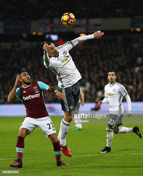 Zlatan Ibrahimovic of Manchester United jumps for a header with Dimitri Payet of West Ham United during the Premier League match between West Ham...