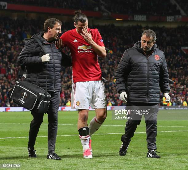 Zlatan Ibrahimovic of Manchester United leaves the match with an injury during the UEFA Europa League quarter final second leg match between...