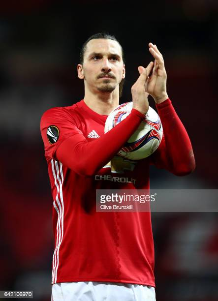 Zlatan Ibrahimovic of Manchester United leaves the pitch with the match ball after scoring a hat-trick during the UEFA Europa League Round of 32...