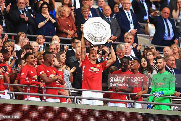 Zlatan Ibrahimovic of Manchester United lifts the Community Shield after the final whistle during The FA Community Shield match between Leicester...