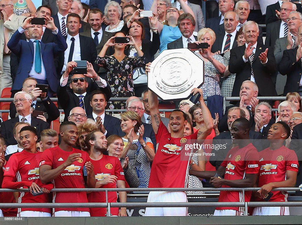 Zlatan Ibrahimovic of Manchester United lifts the Community Shield trophy after the FA Community Shield match between Leicester City and Manchester United at Wembley Stadium on August 7, 2016 in London, England.
