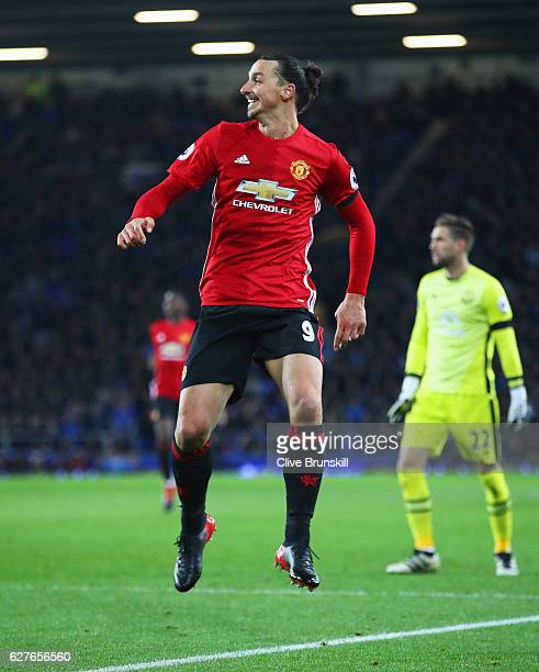 Zlatan Ibrahimovic of Manchester United looks on as he beats Maarten Stekelenburg of Everton as he scores their first goal during the Premier League...