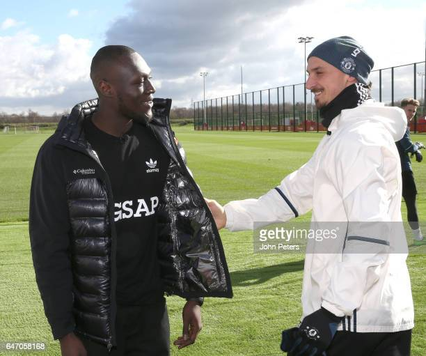 Zlatan Ibrahimovic of Manchester United meets musician Stormzy at Aon Training Complex on March 2 2017 in Manchester England
