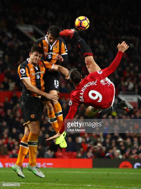 Zlatan Ibrahimovic of Manchester United performs an acrobatic kick with Harry Maguire and Andrea Ranocchia of Hull City during the Premier League...