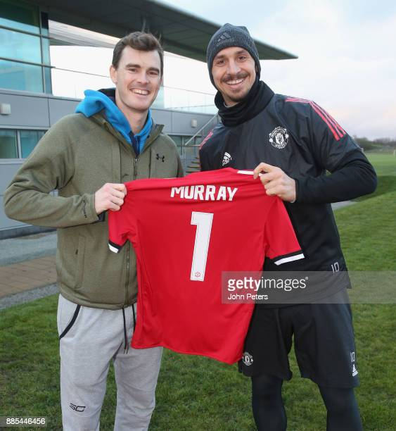 Zlatan Ibrahimovic of Manchester United poses with tennis player Jamie Murray ahead of a first team training session at Aon Training Complex on...