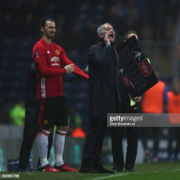 Zlatan Ibrahimovic of Manchester United prepares to enter the field as manager Jose Mourinho gives instructions during the Emirates FA Cup Fifth...