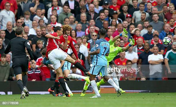 Zlatan Ibrahimovic of Manchester United scores his sides first goal during the Premier League match between Manchester United and Manchester City at...