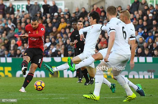 Zlatan Ibrahimovic of Manchester United scores his sides second goal during the Premier League match between Swansea City and Manchester United at...