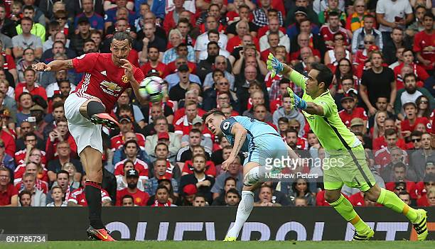 Zlatan Ibrahimovic of Manchester United scores his team's first goal during the Premier League match between Manchester United and Manchester City at...