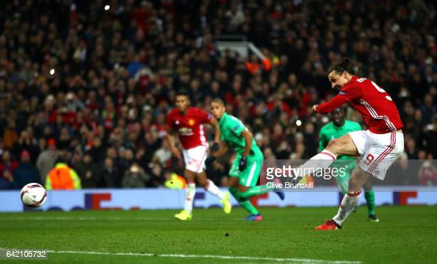 Zlatan Ibrahimovic of Manchester United scores his third and his sides third goal from the penalty spot during the UEFA Europa League Round of 32...