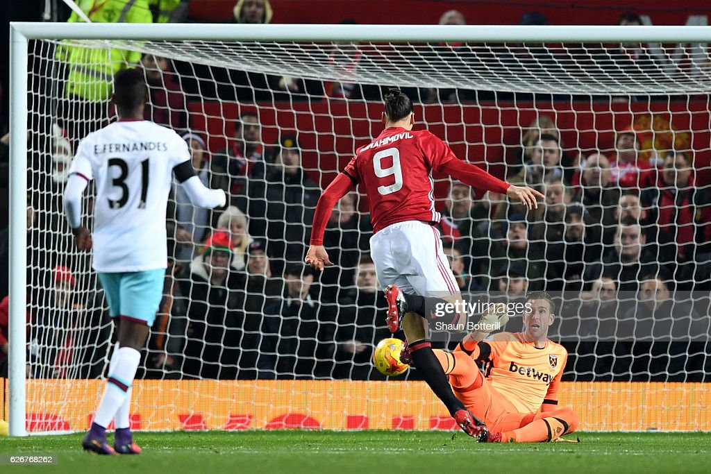 Zlatan Ibrahimovic of Manchester United scores the opening goal past goalkeeper Adrian of West Ham United during the EFL Cup quarter final match between Manchester United and West Ham United at Old Trafford on November 30, 2016 in Manchester, England.