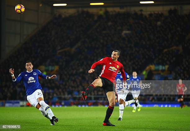 Zlatan Ibrahimovic of Manchester United scores their first goal as Ramiro Funes Mori of Everton looks on during the Premier League match between...