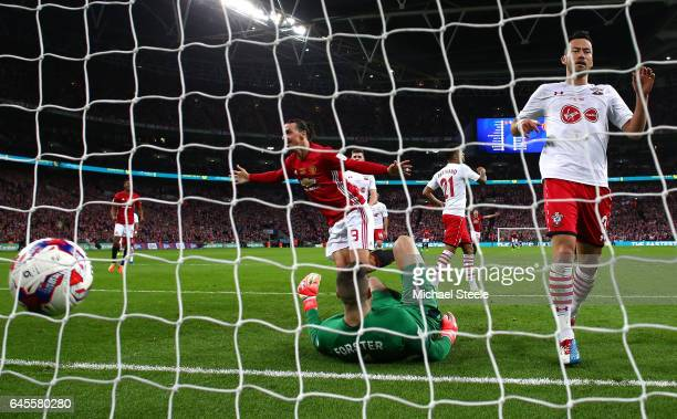 Zlatan Ibrahimovic of Manchester United scores their third goal past goalkeeper Fraser Forster of Southampton during the EFL Cup Final between...