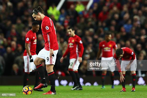 Zlatan Ibrahimovic of Manchester United stands on the ball and looks dejected after Grant Leadbitter of Middlesbrough scores the first goal of the...