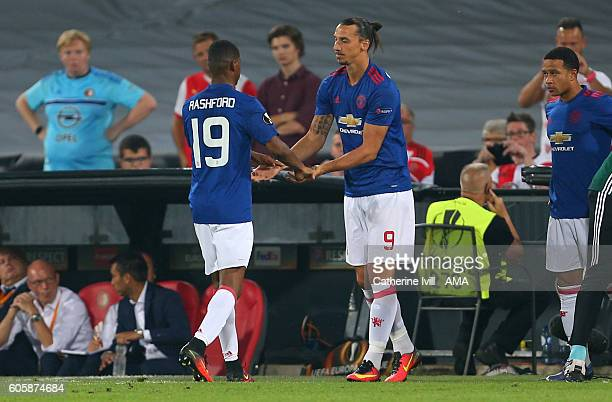 Zlatan Ibrahimovic of Manchester United substitutes Marcus Rashford of Manchester United during the UEFA Europa League match between Feyenoord and...