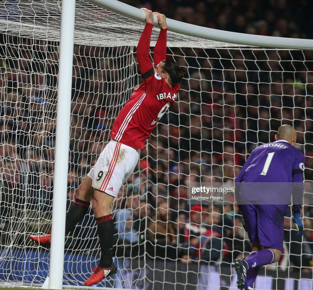 Zlatan Ibrahimovic of Manchester United swings from the crossbar after missing a chance during the Premier League match between Manchester United and Watford at Old Trafford on February 11, 2017 in Manchester, England.