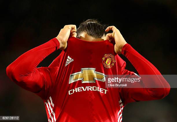Zlatan Ibrahimovic of Manchester United takes his shirt off after the final whistle during the Premier League match between Manchester United and...