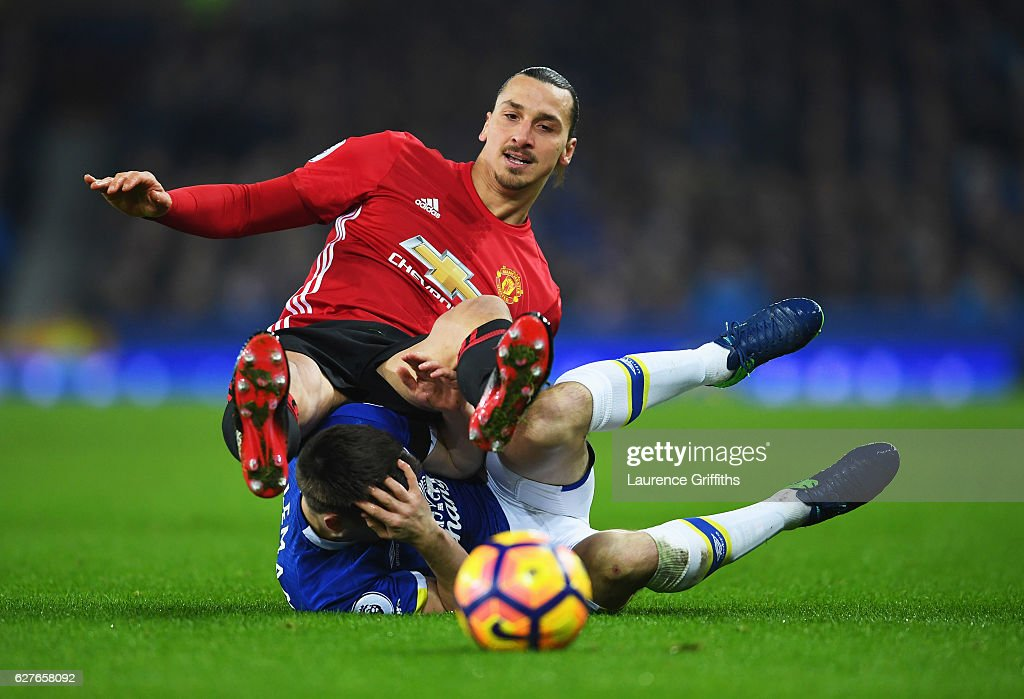Zlatan Ibrahimovic of Manchester United tangles with Seamus Coleman of Everton as they battle for the ball during the Premier League match between Everton and Manchester United at Goodison Park on December 4, 2016 in Liverpool, England.