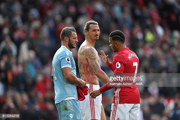 Zlatan Ibrahimovic of Manchester United with his shirt removed showing off his tattoos during the Premier League match between Manchester United and...