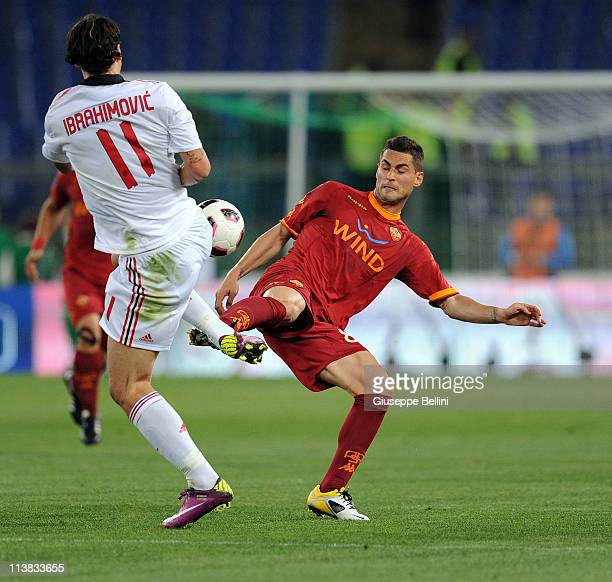Zlatan Ibrahimovic of Milan and Aleandro Rosi of Roma in action during the Serie A match between AS Roma and AC Milan at Stadio Olimpico on May 7...