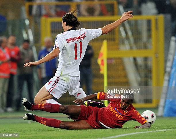 Zlatan Ibrahimovic of Milan and Juan of Roma in action during the Serie A match between AS Roma and AC Milan at Stadio Olimpico on May 7 2011 in Rome...