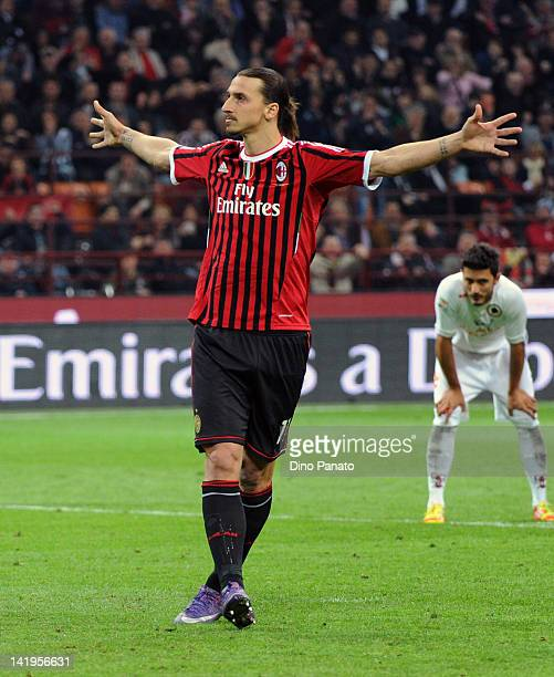 Zlatan Ibrahimovic of Milan celebrates after scoring his first goal during the Serie A match between AC Milan and AS Roma at Stadio Giuseppe Meazza...