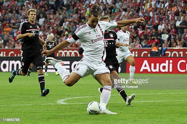 Zlatan Ibrahimovic of Milan scores the first goal during the Audi Cup match between FC Bayern Muenchen and AC Milan at Allianz Arena on July 26 2011...