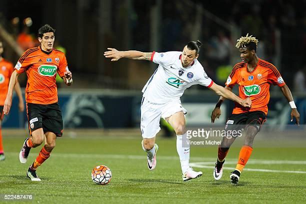 Zlatan Ibrahimovic of Paris Saint Germain and Didier Ndong of Lorient during the semi-final French Cup between Lorient and Paris Saint-Germain at...