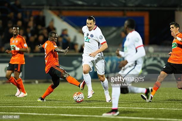 Zlatan Ibrahimovic of Paris Saint Germain and Zarko Toure of Lorient during the semi-final French Cup between Lorient and Paris Saint-Germain at...