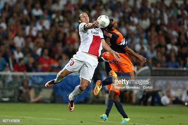 Zlatan Ibrahimovic of Paris Saint Germain Duels for the ball with Hilton of Montpellier HSC during the French Ligue 1 Championship football match...
