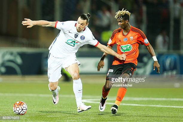 Zlatan Ibrahimovic of Paris Saint-Germain and Didier NDong of Lorient during the semi-final French Cup between Lorient and Paris Saint-Germain at...