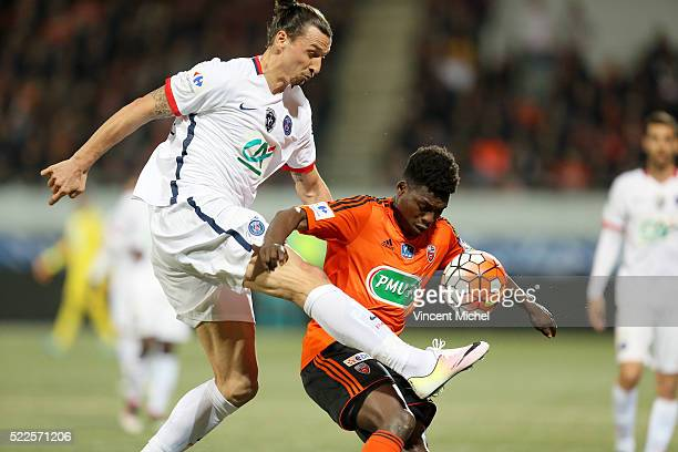Zlatan Ibrahimovic of Paris Saint-Germain and Lamine Gassama of Lorient during the semi-final French Cup between Lorient and Paris Saint-Germain at...