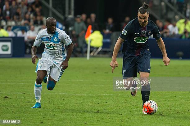 Zlatan Ibrahimovic of Paris SaintGermain and Lassana Diarra of Marseille in action during the final French Cup between Paris SaintGermain and...